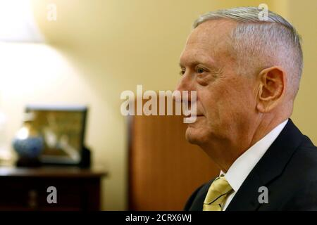 Retired U.S. Marine Corps General James Mattis, President-elect Donald Trump's nominee to be Defense Secretary, sits down to meet with Senate Majority Leader Mitch McConnell in his office at the Capitol in Washington, U.S. December 7, 2016.  REUTERS/Jonathan Ernst - Stock Photo
