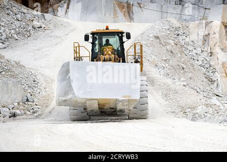 Machinery moving a block of white Carrara marble in a quarry in Tuscany, Italy Stock Photo