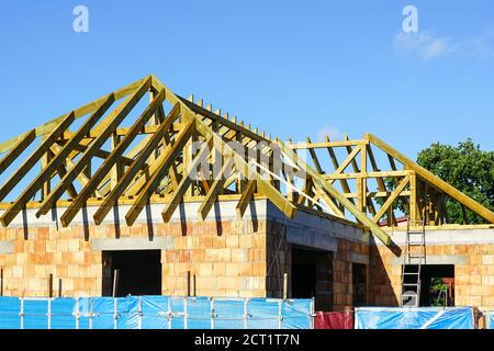 construction of a new residential house roof wooden structure - Stock Photo