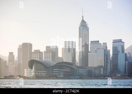 Hong Kong Island at sunset, seen from Victoria Harbour, Hong Kong, China - Stock Photo