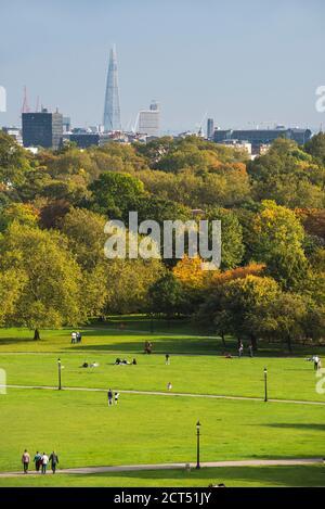 London City Skyline in Autumn seen from Primrose Hill in Chalk Farm, London Borough of Camden, England, United Kingdom - Stock Photo