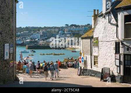Cornwall town, view in summer of people approaching the harbour area in St Ives, Cornwall, south west England, UK
