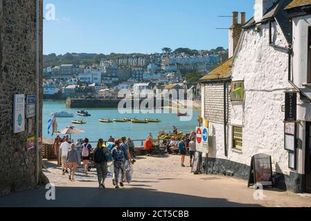 St Ives Cornwall, view in summer of people approaching the harbour area in St Ives, Cornwall, south west England, UK