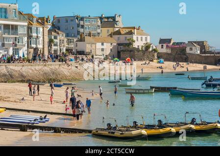 St Ives beach, view in summer of the beach in the harbour area of St Ives, Cornwall, south west England, UK