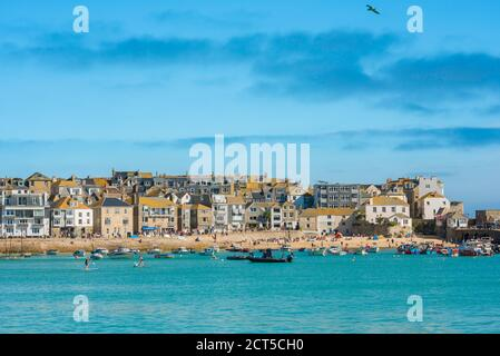 Cornwall property, view in summer across St Ives harbour towards beachfront property, Cornwall, south west England, UK