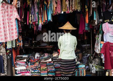 Sewing stall and longyi shop, Hpa An, Kayin State (Karen State), Myanmar (Burma) - Stock Photo