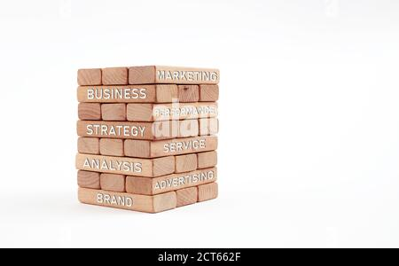 Basic business strategy concepts or words written on stacked wooden blocks.