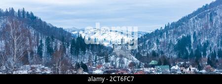 Bran Castle covered in snow in winter, Transylvania, Romania