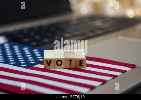 VOTE letter blocks concept on laptop keyboard