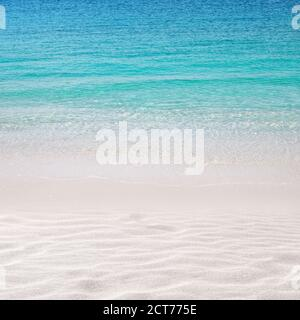 White sandy beach background. Crystal clear turquoise sea. Summer paradise. Wind waves.