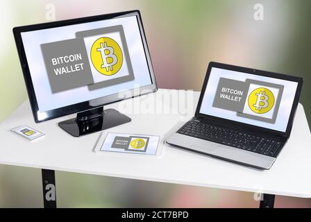Bitcoin wallet concept shown on different information technology devices - Stock Photo