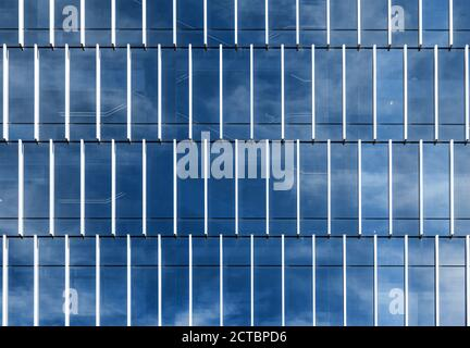 modern exterior with mirror reflex blue sky in architecture background - Stock Photo