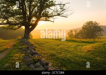 Foggy sunrise on East Cemetery Hill at Gettysburg National Military Park in Gettysburg, PA, USA. - Stock Photo