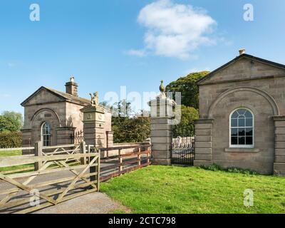 Lodge houses and bridge over the River Nidd listed buildings in Ribston Park Little Ribston near Knaresborough North Yorkshire England - Stock Photo