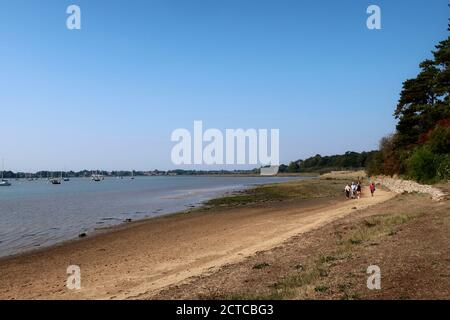 Ramsholt, Suffolk, UK - 22 September 2020: Sunny autumn day for a walk on the beach beside the River Deben. - Stock Photo