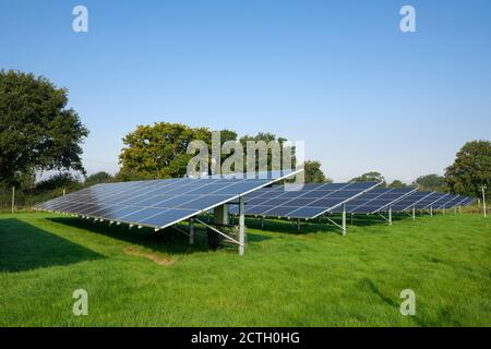 Solar arrays in a field generating electricity near Churchill, North Somerset, England.