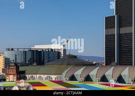 Frankfurt, Hesse, Germany: 2019: Fair trade Frankfurt and German flag on 'Festhalle Frankfurt'. Background: Congress center, Mariott Hotel. - Stock Photo