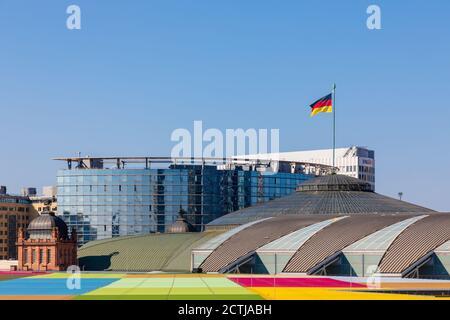 Frankfurt, Hesse, Germany: Fair trade Frankfurt and German flag on 'Festhalle Frankfurt' a multi-purpose arena. Background: Congress center / Maritim - Stock Photo