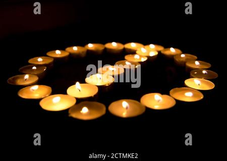 Closeup of Beautiful illuminating and Glowing Group of Earthen Oil lamps on the occasion of Diwali and Christmas in India.
