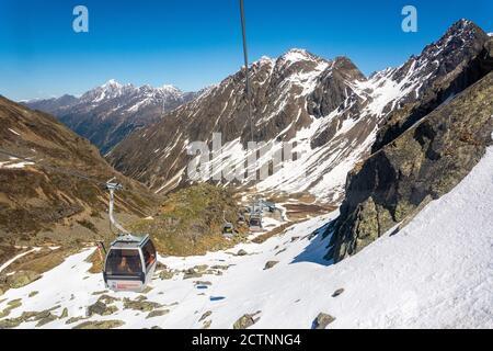 Neustift im Stubaital, Austria – May 27, 2017. Gamsgarten cable car to Stubai Glacier in Tyrol, Austria, with gondolas against the backdrop of mountai - Stock Photo