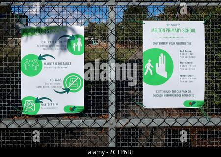 Melton, Suffolk, UK - 24 September 2020: Covid 19 safety rules on a primary school gate. - Stock Photo