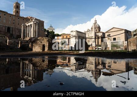 Rome, Italy. 24th September, 2020. Italy Weather: Reflections in puddles after heavy rain in the Forum in Rome, Italy. Photo: Roger Garfield/Alamy Live News - Stock Photo