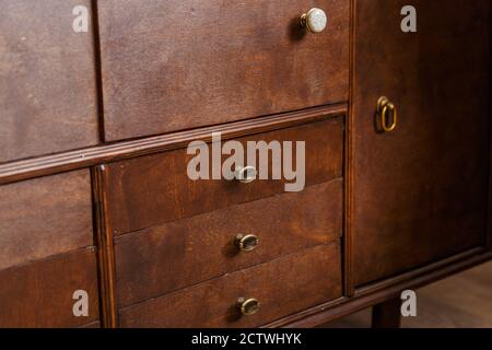 Close up view on handle on old wooden cupboard - Stock Photo