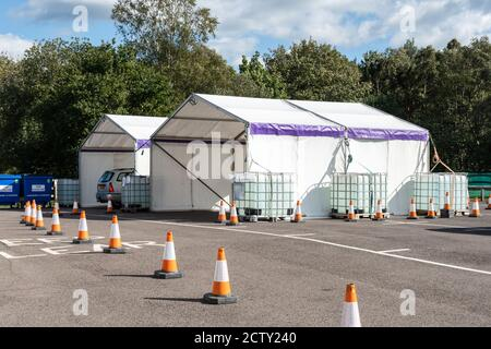 Blackbushe Airport, Hampshire, UK. 25th September 2020. NHS Surrey Heath area have started providing free flu jabs (influenza vaccinations) starting with the over 70's group. These are being carried out at an outdoor drive through facility at Blackbushe Airport just over the border in Hampshire. It is hoped that this year's increased flu vaccination scheme will help to reduce pressure on the NHS and social care staff who may be dealing with coronavirus covid-19. - Stock Photo