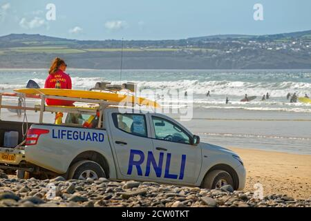 RNLI lifeguard at Gwithian beach, North Cornwall, England. - Stock Photo