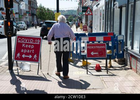 Marlow, Buckinghamshire, UK. 25th June, 2020. An elderly man walks past a Covid-19 Keep Apart sign in Marlow High Street. Credit: Maureen McLean/Alamy - Stock Photo