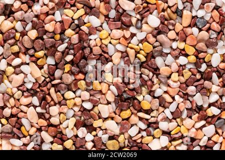 Multi-colored small river stones texture and background.