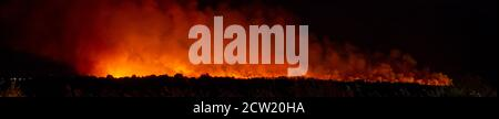 S'Albufera, Majorca, Spain - September 26 2020: Panoramic view of the fire that lasts more than 24 hours in s'Albufera in the area between Muro and Ca - Stock Photo