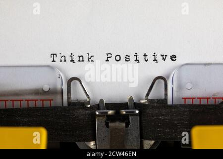 written on old typewriter with text Think Positive - Stock Photo