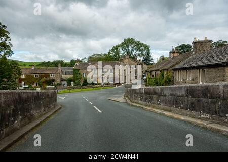 Burnsall village centre - street view of quaint houses from the bridge, Yorkshire Dales, UK