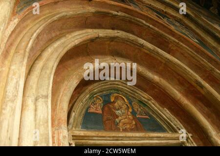 Saint John the New Monastery in Suceava, Romania. Gothic architecture. Fresco depicting the Theotokos. - Stock Photo