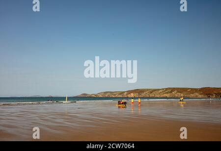 RNLI beach patrol, Newgale beach, West Wales - Stock Photo