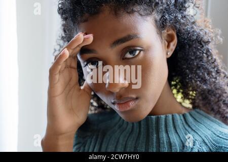 Portrait of sad young black woman feeling bad