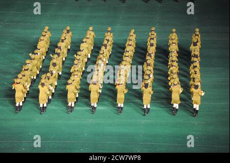 08.08.2012, Pyongyang, North Korea - Military band plays brass band music during the mass choreography and Artistic Performance at Arirang Festival. - Stock Photo