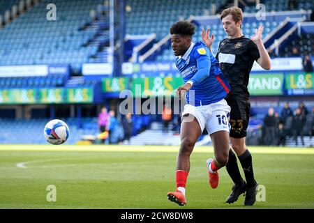 Ellis Harrison of Portsmouth and Chris Merrie of Wigan Athletic in action - Portsmouth v Wigan Athletic, Sky Bet League One, Fratton Park, Portsmouth, UK - 26th September 2020  Editorial Use Only - DataCo restrictions apply - Stock Photo