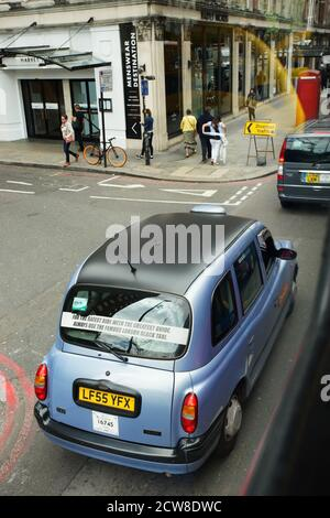 London, UK - July 14, 2017: London Taxi, also called hackney carriage, black cab. Traditionally Taxi cabs are all black in London but now produced in - Stock Photo