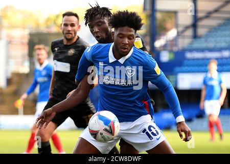 Ellis Harrison of Portsmouth and Viv Solomon-Otabor of Wigan Athletic - Portsmouth v Wigan Athletic, Sky Bet League One, Fratton Park, Portsmouth, UK - 26th September 2020  Editorial Use Only - DataCo restrictions apply - Stock Photo