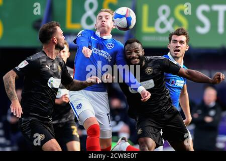 Ronan Curtis of Portsmouth and Nathan Cameron of Wigan Athletic in action - Portsmouth v Wigan Athletic, Sky Bet League One, Fratton Park, Portsmouth, UK - 26th September 2020  Editorial Use Only - DataCo restrictions apply - Stock Photo