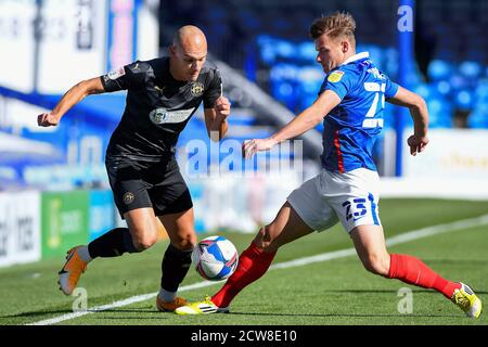 Kal Naismith of Wigan Athletic and Cameron Pring of Portsmouth - Portsmouth v Wigan Athletic, Sky Bet League One, Fratton Park, Portsmouth, UK - 26th September 2020  Editorial Use Only - DataCo restrictions apply - Stock Photo