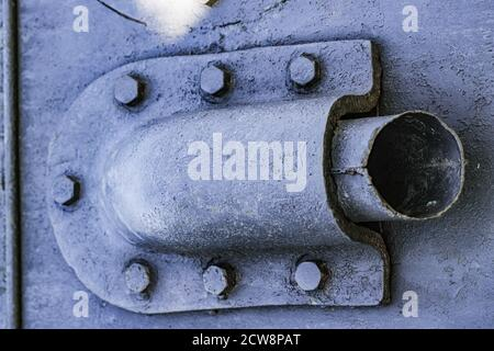 Detail of an old surface with exfoliated paint and rivets on military equipment. Military background. Selected focus