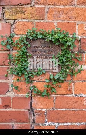 On this site sept 5th 1782 nothing happened plaque on a cotswold stone house in Tewkesbury, Cotswolds, Gloucestershire, England - Stock Photo