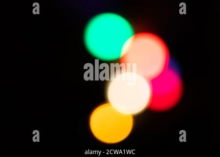 Festive colorful bokeh background with psychedelic colorful sparkles and colorful dots as perfect background for silvester, celebration happy new year