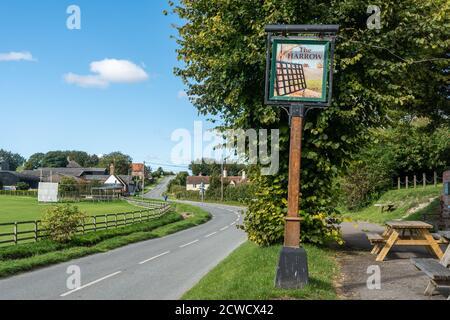 The Harrow pub sign on the main street in West Ilsley, a Berkshire village, UK - Stock Photo