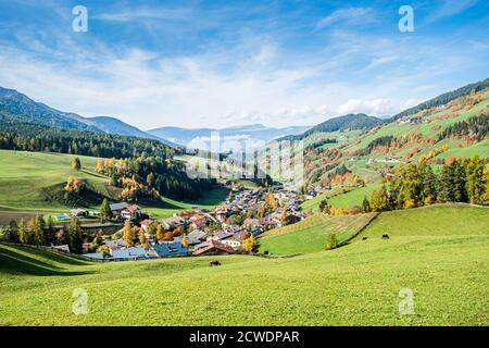 Landscape of early autumn in the village of Santa Magdalena in northern Italy on the slopes of the Dolomites in the valley of Val di Funes.