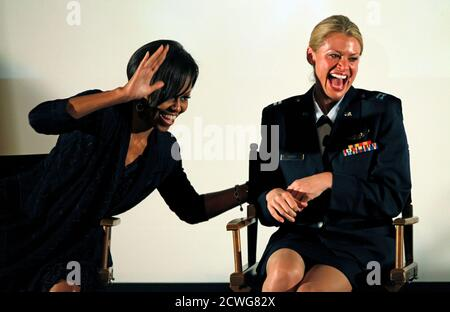 U.S. first lady Michelle Obama (L) waves to family members of California Air National Guard Capt. Kelly Smith, who are currently deployed in Afghanistan, at a Joining Forces event at the Writers Guild theatre in Beverly Hills, California June 13, 2011.   REUTERS/Mario Anzuoni (UNITED STATES - Tags: POLITICS MILITARY IMAGES OF THE DAY) - Stock Photo