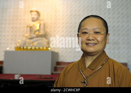 Venerable  Manchien Shih, in charge of Fo Guang Shan temple, a branch of Buddhism based in Taiwan, speaks at the temple in Bussy-Saint Georges, 30 kms east of Paris June 21, 2012.  The European Regional Temple, Europe's biggest Buddhist temple, with be inaugurated on Sunday and open to the public on July 1st. The temple can host up to 1,100 devotees, with a main prayer room which holds 450 people.   REUTERS/Philippe Wojazer  (FRANCE - Tags: RELIGION) Stock Photo